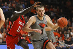 FILE - In this Feb. 13, 2020, file photo, Utah's Both Gach (11) defends against Oregon State's Tres Tinkle (3) during the first half of an NCAA college basketball game in Corvallis, Ore. Tinkle was selected to the Associated Press All Pac-12 first team announced Tuesday, March 10, 2020. (AP Photo/Amanda Loman, File)