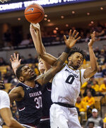 Missouri's Torrence Watson, right, and South Carolina's Chris Silva, left, battle for a rebound during the first half of an NCAA college basketball game Saturday, March 2, 2019, in Columbia, Mo. (AP Photo/L.G. Patterson)