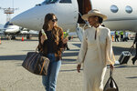 This image released by Focus Features shows Dakota Johnson, left, and Tracee Ellis Ross in a scene from