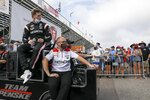 Team pence driver Josef Newgarden, left, exits the track at the Grand Prix of St. Petersburg auto race, Sunday, April 25, 2021 in St. Petersburg, Fla. (Ivy Ceballo/Tampa Bay Times via AP)