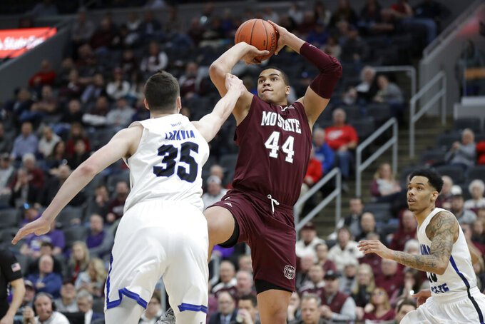 Missouri State's Gaige Prim (44) shoots as Indiana State's Jake LaRavia (35) and Christian Williams, right, defend during the second half of an NCAA college basketball game in the quarterfinal round of the Missouri Valley Conference men's tournament Friday, March 6, 2020, in St. Louis. (AP Photo/Jeff Roberson)