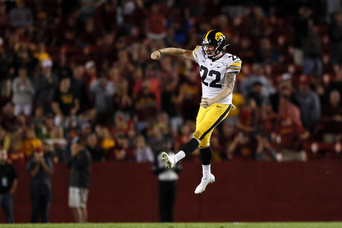 FILE - In this Sept. 14, 2019, file photo, Iowa punter Michael Sleep-Dalton celebrates at the end of an NCAA college football game against Iowa State, in Ames, Iowa. The Big Ten Conference knows the value of having good punters, and they are sometimes willing to go a long way to get them. Sleep-Dalton is a former Australian rules football player who trained at ProKick Australia before coming to the United States.  (AP Photo/Charlie Neibergall, File)