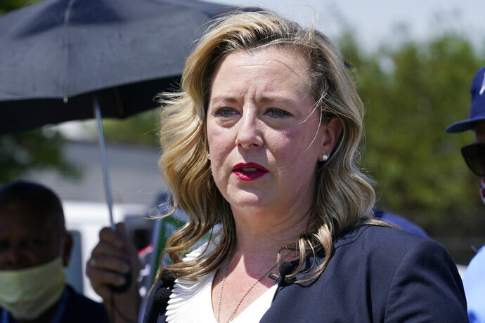 FILE - In this Tuesday, Aug. 18, 2020, file photo, U.S. Rep. Kendra Horn, D-Okla., speaks during a news conference in front of a post office in Oklahoma City. Horn pulled off one of the biggest political upsets in 2018 when she ousted a two-term Republican incumbent. But Horn won't have the element of surprise in this year's contest against Republican state Sen. Stephanie Bice. (AP Photo/Sue Ogrocki, File)