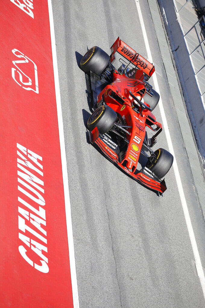 Ferrari driver Sebastian Vettel of Germany drives in the pit lane during a Formula One pre-season testing session at the Catalunya racetrack in Montmelo, outside Barcelona, Spain, Tuesday, Feb. 26, 2019. (AP Photo/Joan Monfort)