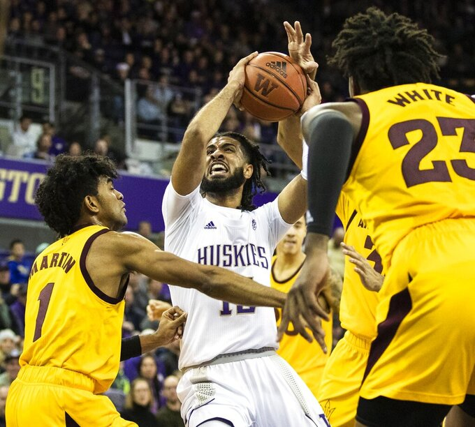 Washington guard Marcus Tsohonis (15) goes in for a shot and is blocked by Arizona State players, including Remy Martin (1), during an NCAA college basketball game Saturday, Feb. 1, 2020, in Seattle. (Amanda Snyder/The Seattle Times via AP)