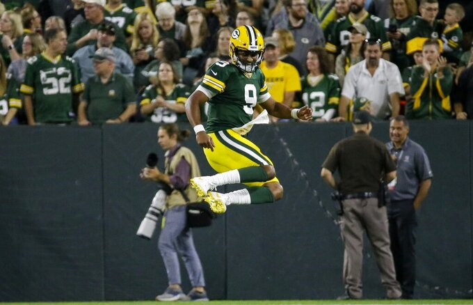 Green Bay Packers' DeShone Kizer celebrates a touchdown pass during the first half of a preseason NFL football game against the Kansas City Chiefs Thursday, Aug. 29, 2019, in Green Bay, Wis. (AP Photo/Mike Roemer)