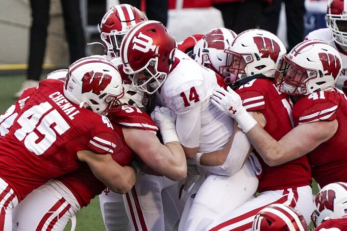 Indiana quarterback Jack TuttleI is stopped on a run during the first half of an NCAA college football game against Wisconsin Saturday, Dec. 5, 2020, in Madison, Wis. (AP Photo/Morry Gash)