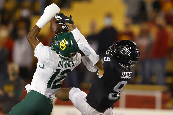Baylor cornerback Kalon Barnes, left, intercepts a pass intended for Iowa State wide receiver Joe Scates during the first half of an NCAA college football game Saturday, Nov. 7, 2020, in Ames, Iowa. (AP Photo/Matthew Putney)