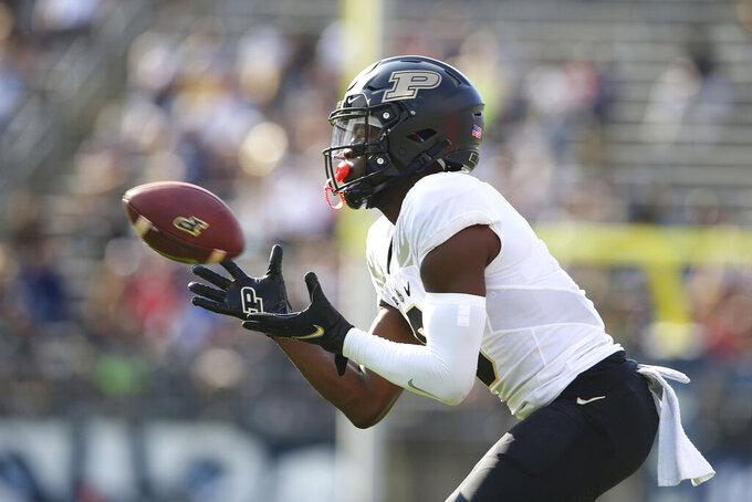 Purdue wide receiver David Bell (3) catches a pass during the first half of an NCAA football game against Connecticut on Saturday, Sept. 11, 2021, in East Hartford, Conn. (AP Photo/Stew Milne)