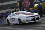In this photo provided by the NHRA, Pro Stock's Aaron Stanfield races to the provisional No. 1 position in his first-round qualifying run in his Janac Brothers Chevrolet Camaro at the DeWalt NHRA Carolina Nationals at zMAX Dragway in Concord, N.C., Friday, Sept. 17, 2021. (Richard H. Shute/NHRA via AP)
