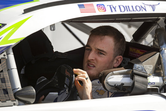 Driver Ty Dillon sits in his car waiting to start qualifying races for Sunday's NASCAR race Saturday, Oct. 5, 2019, in Dover, Del. (AP Photo/Brien Aho)