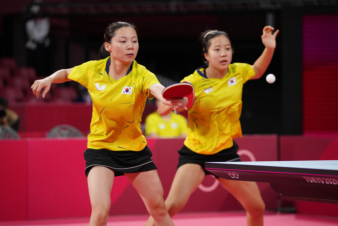 South Korea's Shin Yu-bin, right, and Choi Hyo-joo compete during the table tennis women's team round of 16 against Poland's Natalia Partyka and Natalia Bajor at the 2020 Summer Olympics, Monday, Aug. 2, 2021, in Tokyo. (AP Photo/Kin Cheung)