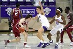 Oklahoma guard Austin Reaves (12) handles the ball as TCU's Francisco Farabello, center, of Argentina, and RJ Nembhard (22) defend in the second half of an NCAA college basketball game in Fort Worth, Texas, Sunday, Dec. 6, 2020. (AP Photo/Tony Gutierrez)