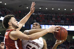 Auburn center Austin Wiley (50) shoots over Alabama forward Alex Reese (3) during the first half of an NCAA college basketball game, Wednesday, Feb. 12, 2020, in Auburn, Ala. (AP Photo/Julie Bennett)