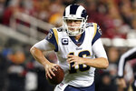 Los Angeles Rams quarterback Jared Goff rolls out to pass against the San Francisco 49ers during the first half of an NFL football game in Santa Clara, Calif., Saturday, Dec. 21, 2019. (AP Photo/Tony Avelar)