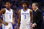 Kentucky's Immanuel Quickley (5) and Tyrese Maxey (3) and coach John Calipari confer during the second half of the team's NCAA college basketball game against Vanderbilt in Lexington, Ky., Wednesday, Jan 29, 2020. (AP Photo/James Crisp)
