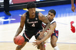 South Carolina's Jalyn McCreary (4) protects the ball from Mississippi's Luis Rodriguez in the second half of an NCAA college basketball game in the Southeastern Conference Tournament Thursday, March 11, 2021, in Nashville, Tenn. (AP Photo/Mark Humphrey)