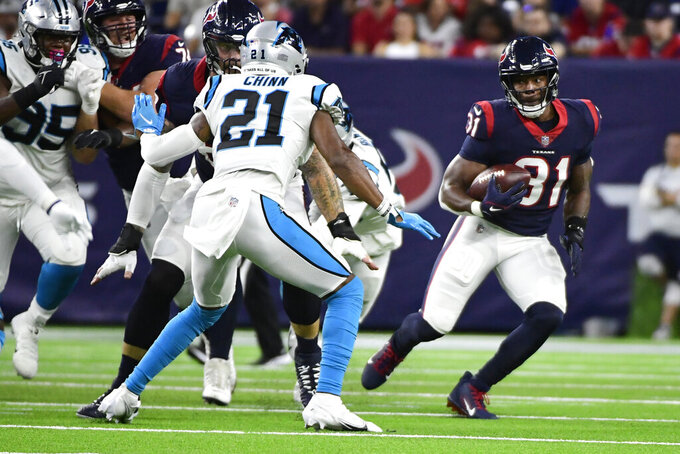 Houston Texans running back David Johnson (31) rushes for a gain as Carolina Panthers safety Jeremy Chinn (21) defends during the first half of an NFL football game Thursday, Sept. 23, 2021, in Houston. (AP Photo/Justin Rex)