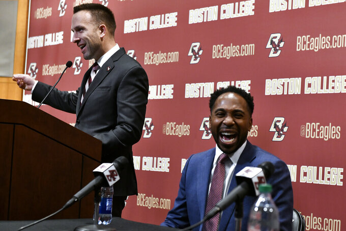 From left, Jeff Hafley and Director of Athletics Martin Jarmond smile during a news conference where Hafley was introduced as the new NCAA college football head coach at Boston College, Monday, Dec. 16, 2019, in Boston. (AP Photo/Josh Reynolds)