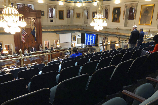 Several members of the South Carolina House choose to practice social distancing and sit in the balcony on Thursday, March 19, 2020, in Columbia, S.C.. The House returned briefly to approve $45 million in emergency funds for state health officials to fight coronavirus.  (AP Photo/Jeffrey Collins)