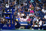 The chair umpire has words with Nick Kyrgios, of Australia, during the first round of the US Open tennis championships, Monday, Aug. 30, 2021, in New York. (AP Photo/Frank Franklin II)