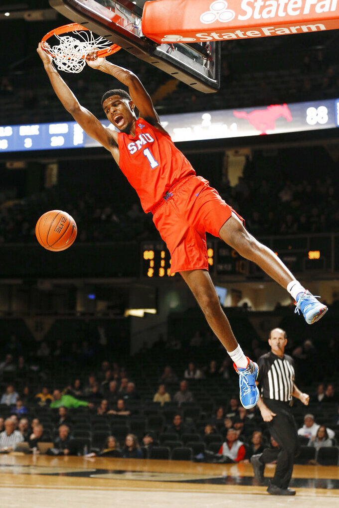SMU forward Feron Hunt dunks against Vanderbilt in overtime of an NCAA college basketball game Saturday, Jan. 4, 2020, in Nashville, Tenn. (AP Photo/Mark Humphrey)
