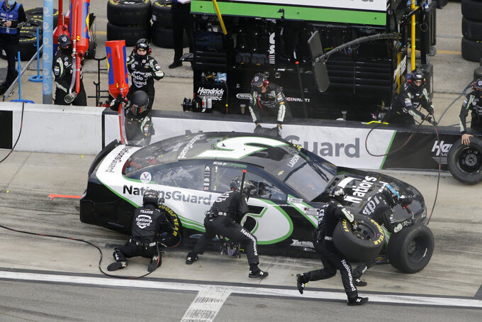 Kyle Larson makes a pit stop during the NASCAR Cup Series road course auto race at Daytona International Speedway, Sunday, Feb. 21, 2021, in Daytona Beach, Fla. (AP Photo/Terry Renna)