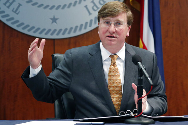 Mississippi Republican Gov. Tate Reeves provides reporters an update on the state's response to COVID-19, Wednesday, April 29, 2020, in Jackson, Miss. Reeves was joined by the state's two Republican U.S. Sens. Roger Wicker and Cindy Hyde-Smith. (AP Photo/Rogelio V. Solis)