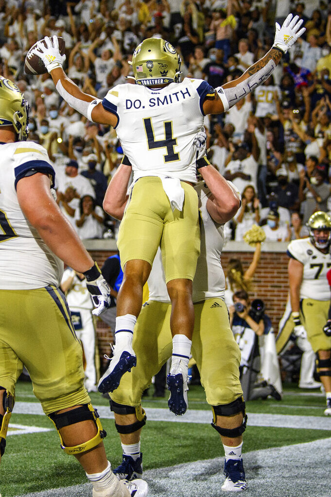 Georgia Tech running back Dontae Smith (4) is lifted by offensive lineman Ryan Johnson during the second half of the team's NCAA college football game against Northern Illinois on Saturday, Sept. 4, 2021, in Atlanta. (AP Photo/Danny Karnik)