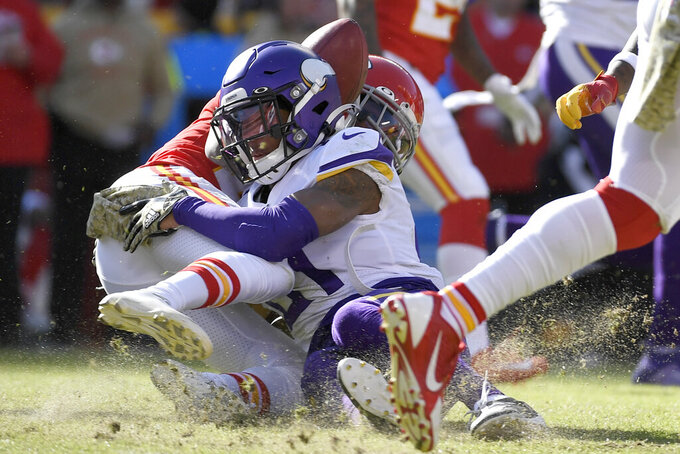 Kansas City Chiefs wide receiver Mecole Hardman, rear, fumbles the ball for a turnover after a hit by Minnesota Vikings cornerback Mike Hughes (21) during the second half of an NFL football game in Kansas City, Mo., Sunday, Nov. 3, 2019. (AP Photo/Reed Hoffmann)