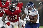 Tennessee Titans running back Mekhi Sargent (38) eludes Tampa Bay Buccaneers linebacker K.J. Britt (52) on a run during the first half of an NFL preseason football game Saturday, Aug. 21, 2021, in Tampa, Fla. (AP Photo/Jason Behnken)