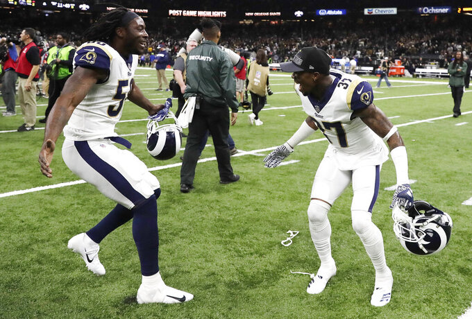 Los Angeles Rams cornerback Sam Shields right, and Los Angeles Rams Cory Littleton (58) celebrate after overtime of the NFL football NFC championship game against the New Orleans Saints, Sunday, Jan. 20, 2019, in New Orleans. The Rams won 26-23. (AP Photo/Carolyn Kaster)