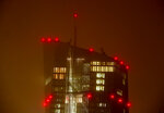 Red lights shine from the European Central Bank ahead of President Mario Draghi chairing his last ECB policy meeting in Frankfurt, Germany, Thursday, Oct. 24, 2019. (AP Photo/Michael Probst)