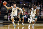 Vanderbilt guard Scotty Pippen Jr. (2) and Maxwell Evans (3) head down the floor in the first half of an NCAA college basketball game against Southeastern Louisiana Monday, Nov. 25, 2019, in Nashville, Tenn. (AP Photo/Mark Humphrey)