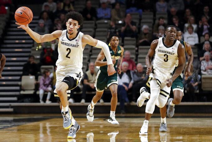 Vanderbilt guard Scotty Pippen Jr. (2) and Maxwell Evans (3) head down the floor in the first half of an NCAA college basketball game against Southeastern Louisiana Monday, Nov. 25, 2019, in Nashville, Tenn. (AP Photo/Mark Humphrey)