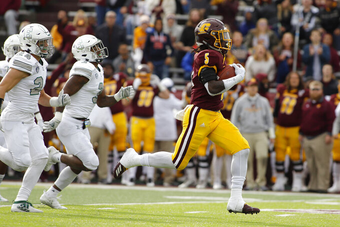 FILE - In this Oct. 5, 2019, file photo, Central Michigan's Jonathan Ward, right, breaks away from Eastern Michigan's Brody Hoying, left, and Vince Calhoun for a 64-yard touchdown on a pass reception during the second quarter of an NCAA football game in Mount Pleasant, Mich. Central Michigan and San Diego State meet Saturday, Dec. 21, 2019, in the New Mexico Bowl in Albuquerque, N.M. in a game expected to be a defensive battle. (AP Photo/Al Goldis, File)