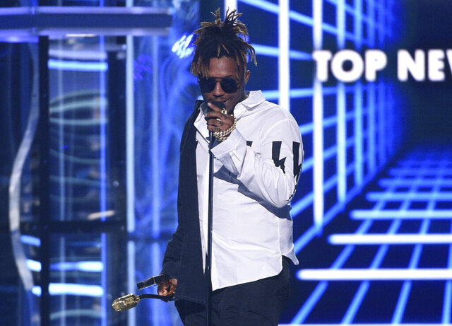 FILE - In this May 1, 2019 file photo, Juice WRLD accepts the award for top new artist at the Billboard Music Awards at the MGM Grand Garden Arena in Las Vegas. The Chicago-area rapper, whose real name is Jarad A. Higgins, was pronounced dead Sunday, Dec. 8 after a