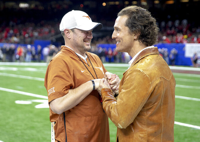Texas coach Tom Herman speaks with actor Matthew McConaughey before the team's Sugar Bowl NCAA college football game against Georgia on Tuesday, Jan. 1, 2019, in New Orleans. (Nick Wagner/Austin American-Statesman via AP)