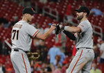San Francisco Giants relief pitcher Tyler Rogers (71) celebrates with teammate Curt Casali after finishing off the St. Louis Cardinals in the ninth inning of a baseball game, Friday, July 16, 2021, in St. Louis. (AP Photo/Tom Gannam)
