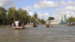 In this image made from video, residents move through floodwaters using makeshift rafts in Afgoye, Somalia Sunday, Aug. 9, 2020. Severe flooding continues to displace thousands of people in Somalia and the government in recent days has issued new warnings to communities living along the Jubba and Shabelle rivers. (AP Photo)