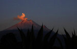 The Popocatepetl volcano releases a plume of ash as seen from the flanks of the Iztaccíhuatl volcano, near Santiago Xalitzintla, Mexico. Veronica Agustin says the community has gotten used to living with Don Goyo, a nickname for Popocatepetl. When Don Goyo gets angry, the ground vibrates, doors and windows shake -- she compares the sound to that of beans cooking in boiling water.