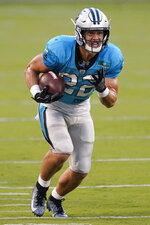 FILE - Carolina Panthers running back Christian McCaffrey runs a play during an NFL football camp practice Wednesday, Aug. 26, 2020, in Charlotte, N.C. The Panthers play the Raiders on Sunday, Sept. 13. (AP Photo/Chris Carlson, File)