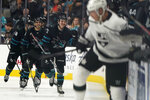 San Jose Sharks center Noah Gregor, center, celebrates with teammates on the bench after scoring a goal against the Los Angeles Kings during the second period of an NHL hockey game in San Jose, Calif., Friday, Nov. 29, 2019. (AP Photo/Tony Avelar)