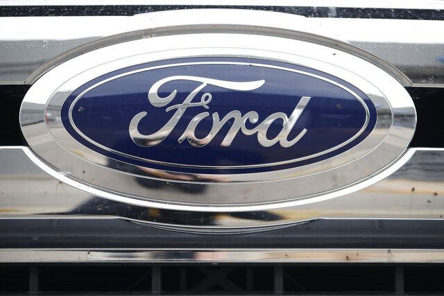 FILE - In this  Oct. 20, 2019 file photograph, the company logo shines off the grille of an unsold 2019 F-250 pickup truck at a Ford dealership in Littleton, Colo. Ford Motor Co. reports quarterly financial results after the market close, Thursday, July 30 2020. (AP Photo/David Zalubowski, File)