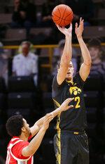 Iowa forward Jack Nunge (2) shoots a three-point basket against Ohio State in the first half of an NCAA college basketball game in Iowa City, Iowa, Thursday, Feb. 4, 2021. (Rebecca F. Miller/The Gazette via AP)