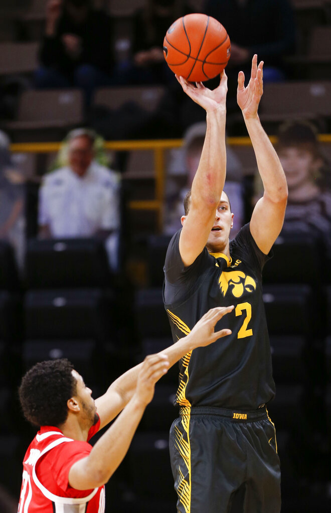 Iowa forward Jack Nunge (2) shoots a three-point basket against Ohio State in the first half of an NCAA college basketball game in Iowa City, Iowa, Thursday, Feb. 4, 2021. (Rebecca F. Miller/The Gazette via AP)