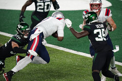 New England Patriots quarterback Cam Newton, center, rushes for a touchdown during the first half of an NFL football game against the New York Jets, Monday, Nov. 9, 2020, in East Rutherford, N.J. (AP Photo/Corey Sipkin)