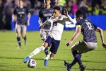 Virginia's Nathaniel Crofts (10) handles the ball ahead of Georgetown's Dylan Nealis (12) during the second half of the NCAA college soccer championship in Cary, N.C., Sunday, Dec. 15, 2019. (AP Photo/Ben McKeown)
