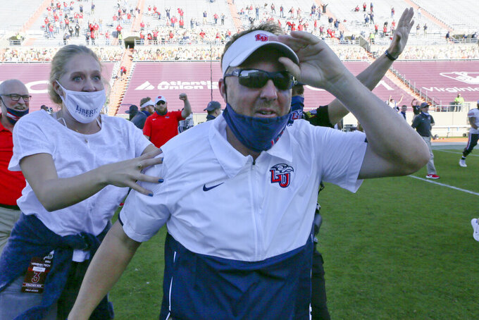 Liberty Head Coach Hugh Freeze celebrates after they defeated the Virginia Tech in an NCAA college football game, Saturday, Nov. 7 2020, in Blacksburg, Va. (Matt Gentry/The Roanoke Times via AP, Pool)