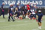 New England Patriots players take the field before an NFL football training camp scrimmage, Friday, Aug. 28, 2020, in Foxborough, Mass. Head coach Bill Belichick is at right. (AP Photo/Michael Dwyer, Pool)
